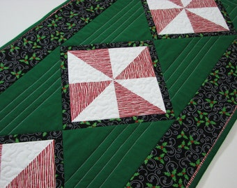 "Christmas Quilted Table Runner, Christmas Table Mat, Peppermint Stripe Pinwheels and Holly, Green Red Black, 35""x16"", Quiltsy Handmade"