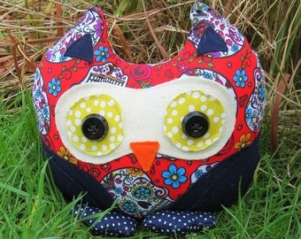 An owl doorstop made from a vibrant Sugar Skulls cotton.  Owl bookend.  Dark whimsical.