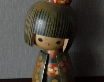 Wooden geisha girl