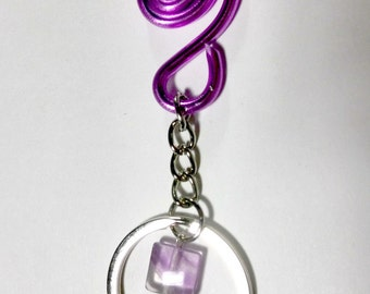 Keychain clinging to purple bag with a Pearl Amethyst