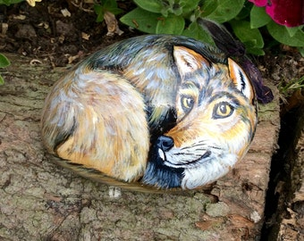 Wolf hand painted pebble