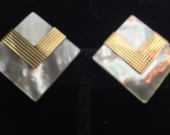 Mother of pearl and 14 k gold clip on vintage earrings.
