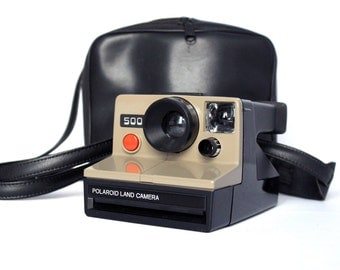 Polaroid 500 Land Camera (Rare edition)  [includes Original Polaroid Soft case]