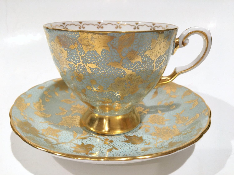 luscious tuscan tea cup and saucer tea set aqua gold cups. Black Bedroom Furniture Sets. Home Design Ideas