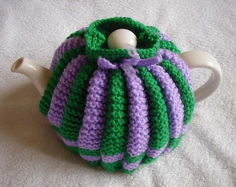 Handmade Knitted Tea Cosy In DK Colour Green And Lilac