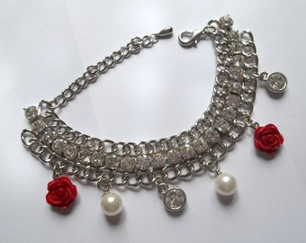 Charms bracelet with white pearls, crystals and rose coral