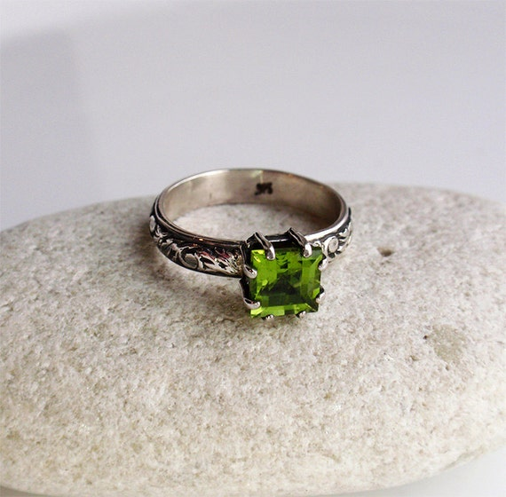 April -  sterling silver ring with natural peridot