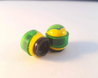 Lego helmet valve cap, yellow with green visor. Accessory for your car or bike. Made from genuine Lego.