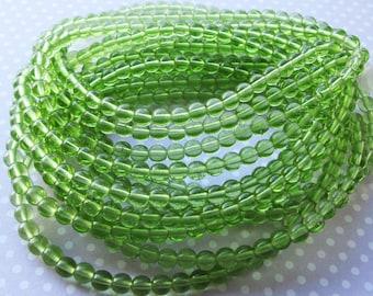 Czech Pressed Glass Round Beads, Druk, 5mm, 40 beads, Transparent Peridot