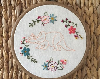 Dinosaur embroidery hoop with flower wreath
