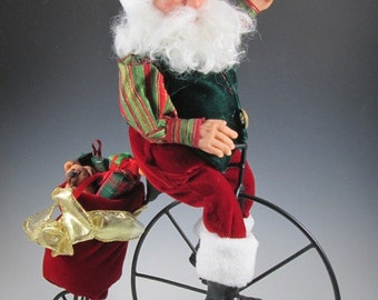 Santa on a Bicycle OOAK Santa Art Doll/Hand Sculpted Polymer