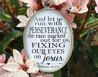"""Bible Verse Pendant Necklace """"And let us run with perseverance the race marked out for us, fixing our eyes on Jesus. Hebrews 12:1-1-2"""""""