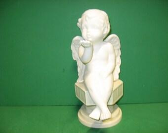 Ceramic bisque shelf cherub blowing a kiss... u paint it