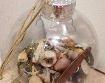 Clear Ornament with sand and Hawaiian Shells with a Hemp Cord