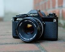 Vintage Black Canon AV1 w/ Canon Lens 50mm 1.8. S.C.- Made in Japan