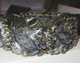 """vintage metal bangle clasp style 8.50""""long almost 1"""" wide shades of black,grey,bronze good condition"""