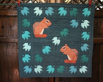 Small Quilt Hanging of Two Squirrels with leaves and acorns