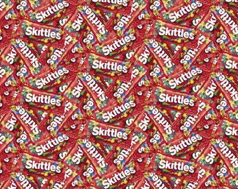 Skittles candy on red cotton fabric, Springs Creative