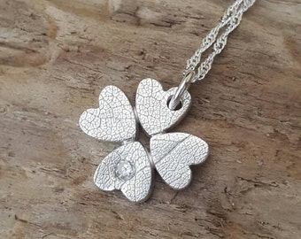 Fine silver four leaf clover with a stone