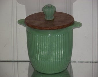 Vintage ribbed Jadite sugar dish with a 2 part oaken lid and a fluted Jadite glass knob.