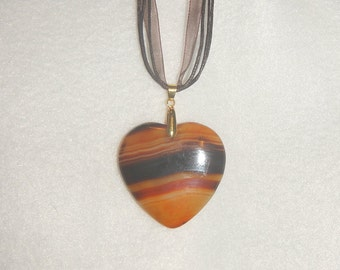 Heart-shaped Golden Yellow/Orange/Brown Striped Onyx Agate pendant (JO501)