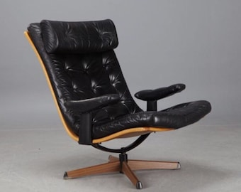 Great Swedish black leather revolving armchair/ easychair/ lounge chair, Mid Century Vintage