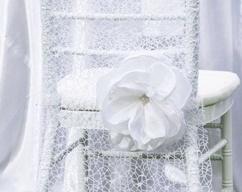 Net chair cover with flower.