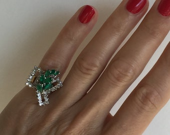 An 18k Abstract Emerald and Diamond  1970s Ring
