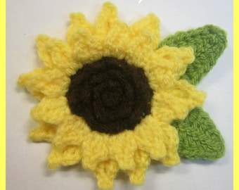Yellow and green crochet sunflower brooch with crochet leaves