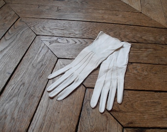 A pair of French vintage short white kid gloves