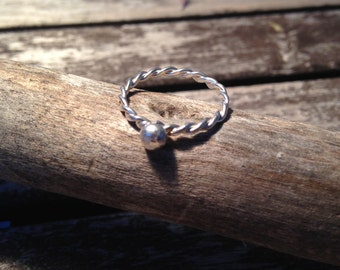 Twisted ring with silver ball