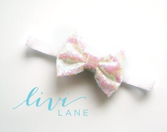 6-12 Months (15 inches): Mini Sparkle Pearl bow on Pearl Sparkle elastic. FINAL SALE
