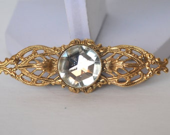 Victorian Style Gold Tone Filigree Setting Clear Faceted Crystal Center Sash Pin Brooch