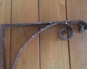 Large old iron plant bracket