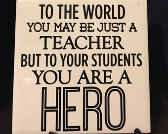 To the World you may be a TEACHER but to your students your are a HERO Tile