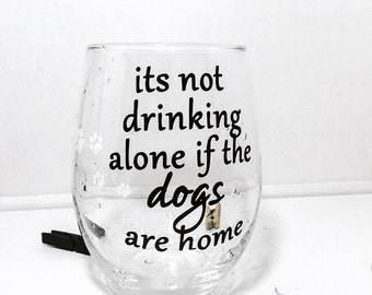 Its not drinking alone if the dogs are home | Stemless Wine Glass || Funny Wine Glass. Dog Mom Wine Glass.