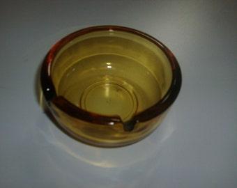 Vintage 3 3/4 inch amber glass ashtray.