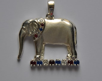Sterling silver elephant pendant with red, white and blue collar and accent bar