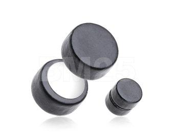 A Pair of Ebony Wood Magnet Fake Plug