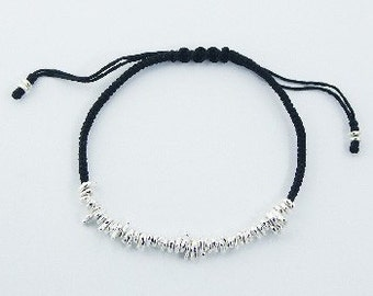 sterling silver and waxed cotton bracelet