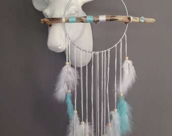 Dream catcher in driftwood, turquoise and white colour.