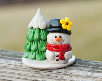Snowman with Red Scarf and Snowy Tree
