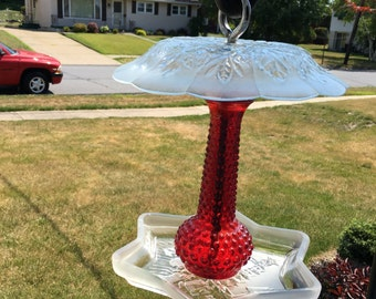 Red and clear glass bird feeder