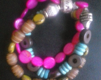 Three strand buri seed and glass and shell bead stretch boho bracelet