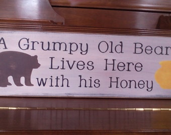 A Grumpy Old Bear Lives Here with the Honey of His Life