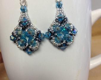 Bead weaved earrings in teal blue...