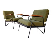 Mid Century style iron lounge chairs.