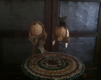 primitive bunny heads on a bed spring