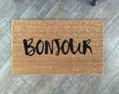 Bonjour welcome mat. Hand painted, customizable doormat gives your visitors a warm, worldly greeting. Great housewarming gift!