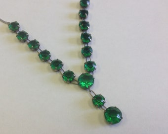 Vintage Art Deco sterling silver and emerald paste necklace, patent dates to 1928.